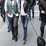 She showed off her distressed denim and edgy leather Balenciaga moto jacket when she visited George on set, completing her outfit with Ash wedge sneakers and an unexpected feminine touch in the form of an eyelet tee.