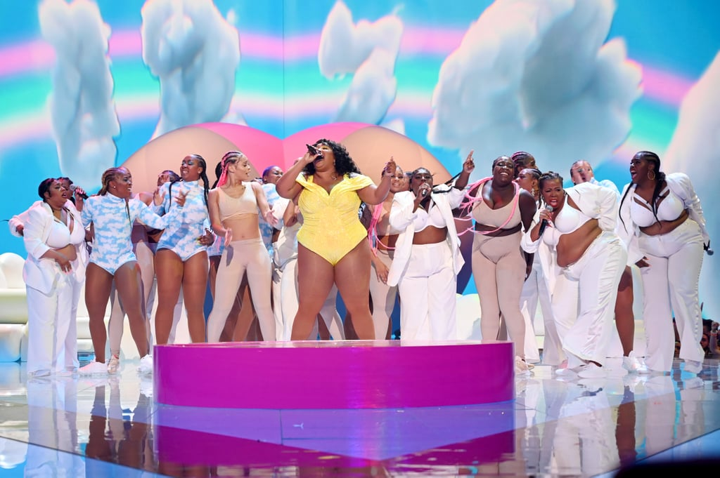 "Lizzo manages to inject a good dose of cheer in all her performances, and the 2019 MTV VMAs were no different! The 31-year-old singer took the stage to perform a rousing medley of her hit singles ""Good as Hell"" and ""Truth Hurts,"" complete with a giant butt balloon and cloud props all over the stage. Though she started her performance with the clapback anthem about washing ain't-good-for-nothing men out of your hair, she smoothly transitioned into ""Good as Hell,"" enforcing the song's self-love message with an outfit change into a bright yellow bodysuit with dancers wearing cloud-print bodysuits as they crooned along with her.  ""Let me talk to y'all for a second,"" she said, stepping onto a platform during the song's breakdown. ""I'm tired of the bullsh*t and I don't have to know your story to know that you're tired of the bullsh*t too. It's so hard trying to love yourself in a world that doesn't love you back, am I right? So I want to take this opportunity right now to just feel good as hell! Because you deserve to feel good as hell!"" Preach, sister Lizzo! It's unsurprising that Lizzo's performance had the entire audience on their feet — shoot, there were probably viewers at home on their feet as well! We'll definitely be coming back to this performance whenever we need cheering up, but for now keep scrolling to check it out, and get an eyeful of all the gorgeous shots from her performance, too.      Related:                                                                                                           Lizzo Was Feeling Herself at the MTV VMAs, and We Wouldn't Want It Any Other Way"