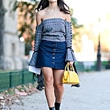 A dramatic off-the-shoulder sleeve top takes your denim skirt game to the next level.
