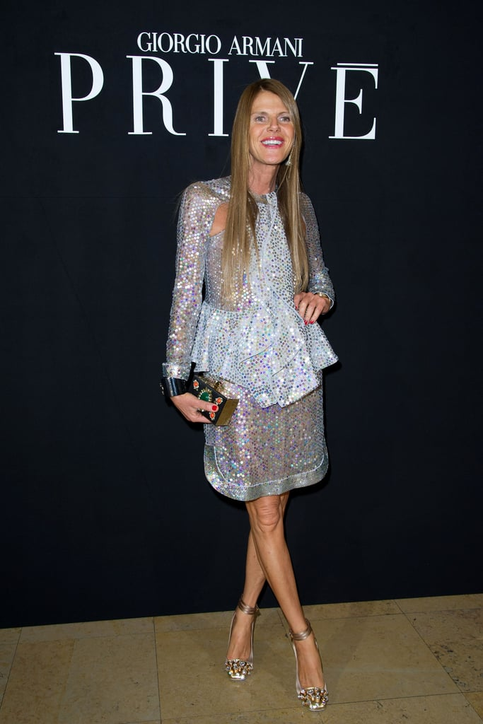 Anna Dello Russo headed to the Armani Privé show in a peplum-trimmed, paillette-covered jacket and skirt set.