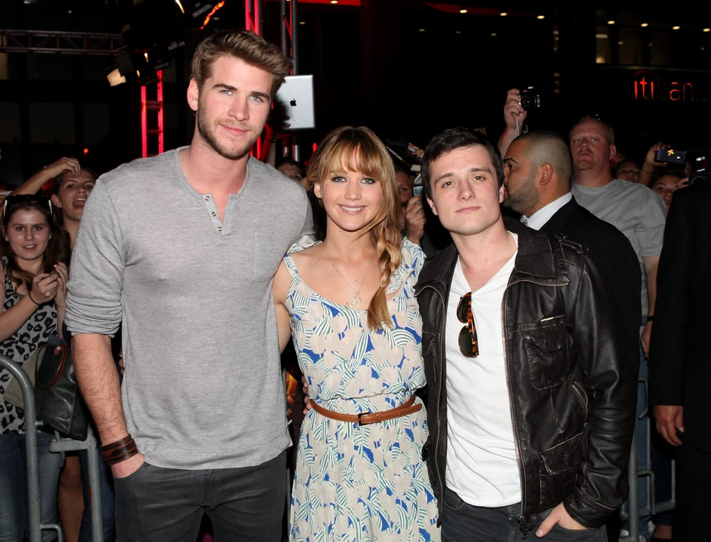 Jennifer Lawrence, Liam Hemsworth, and Josh Hutcherson greeted fans and signed autographs at the Westfield Century City mall in LA on Saturday. Jennifer was decked out in Tory Burch for the event. It's the first stop on their publicity tour for The Hunger Games, which barrels into theaters on March 23. The trio were coming straight from their press junket earlier in the day, where we chatted with the cast about everything from what it was like stepping into the arena to the kissing skills of their costars. Jennifer is at the center of The Hunger Games excitement, but she recently revealed that she had some reservations about taking the role. Jennifer spoke about taking on the role of Katniss and her worries about attention and stardom for her March Glamour cover story. At least she gets to have Josh and Liam by her side, and we can expect to see a lot more of these three in the coming weeks leading up to The Hunger Games' release.