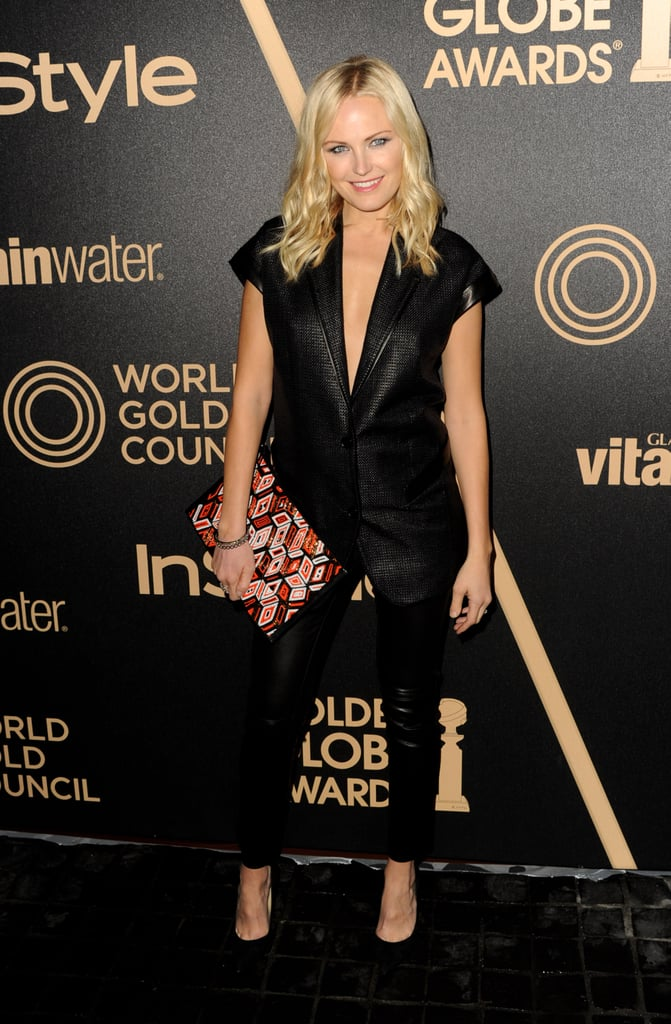 Malin Akerman worked a sexier take on the menswear-inspired trend in a short-sleeved blazer with a plunging neckline, slim black pants, and pumps. We also love the shot of print on her clutch.
