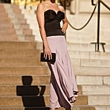 Get party-ready with a black-tie inspired bustier top to pair with your subtly colored silk skirt.
