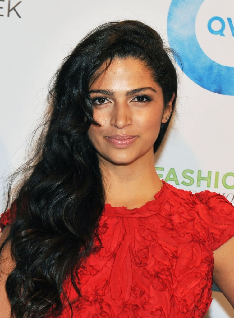 Camila Alves in a red dress at QVC's runway show.