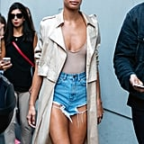 Sarah Sampaio added coverage to barely there denim with a trench coat. The layer also helped add sophistication.