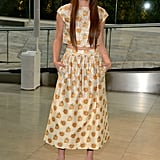 Hailee Steinfeld showed just enough midriff in a printed Suno ensemble, finished with gold Jimmy Choo sandals and Jennifer Meyer jewels.