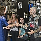 Kate shook hands with a punk while visiting a drop-in center for homeless and young people in Quebec back in July 2011.
