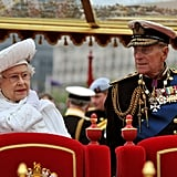 The queen and her husband stood together on the royal barge.