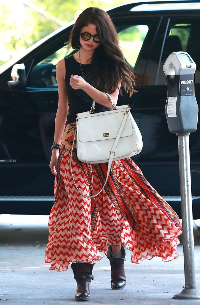 Selena Gomez worked an eclectic printed maxi skirt with mirrored sunglasses and a white Dolce & Gabbana bag in Hollywood.