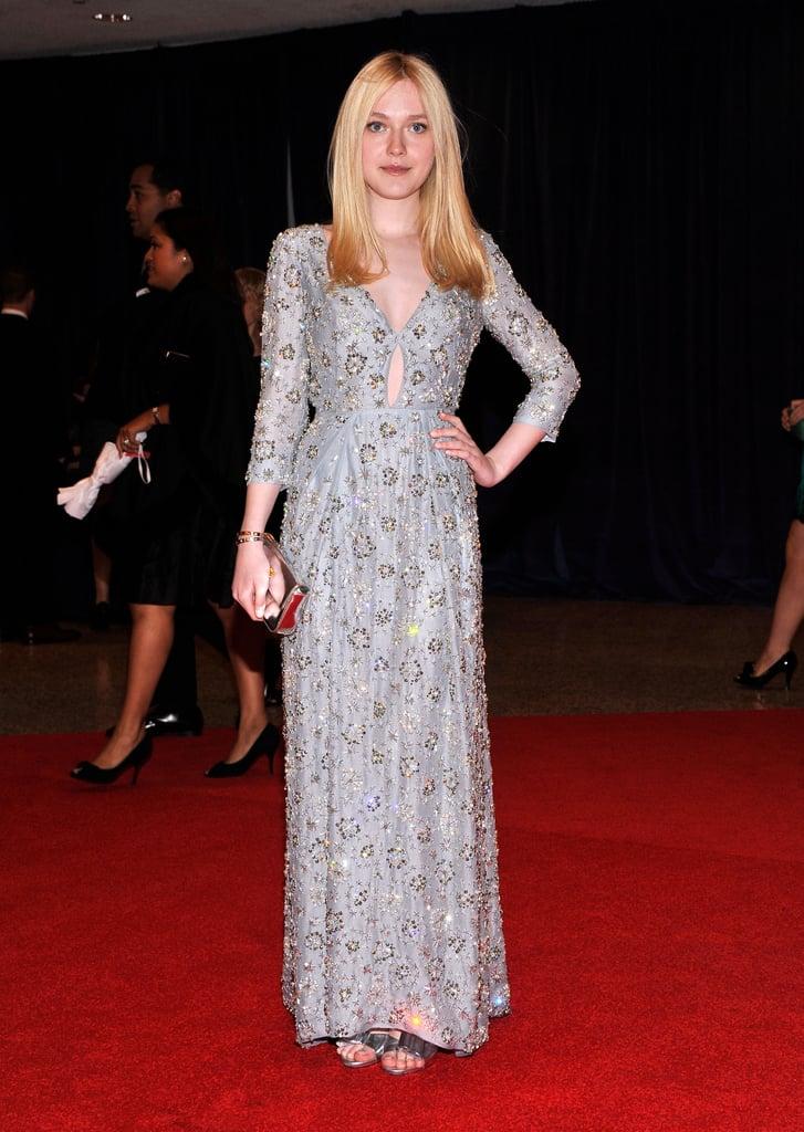 Dakota Fanning wore a long silver dress.