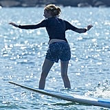 Emma Stone had a hard time balancing on her board.