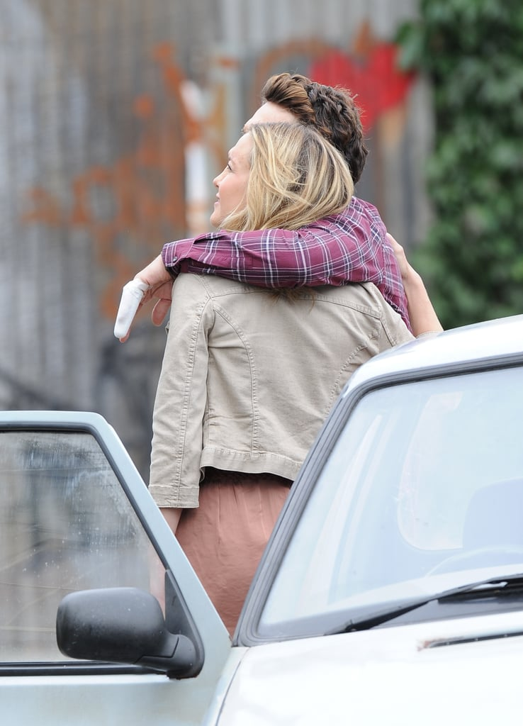 James Franco had his arm around Kate Hudson on set in London.