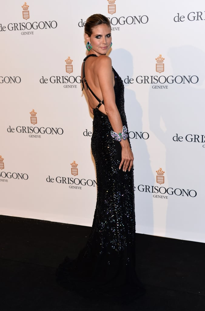 Heidi Klum revealed a seriously sexy back on her Roberto Cavalli gown.