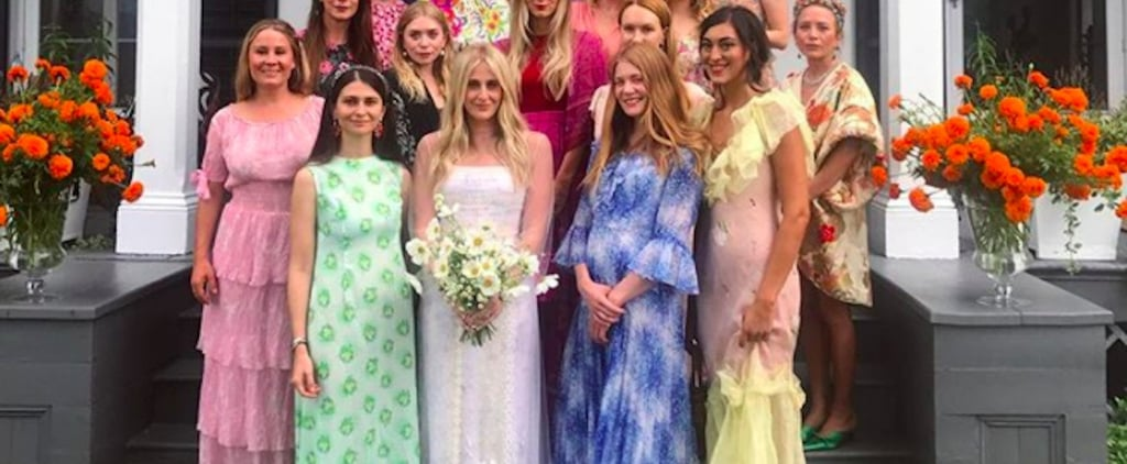 This Bride's Sheer-Sleeved Wedding Gown Is Covered in Mesmerizing Yellow Daisies