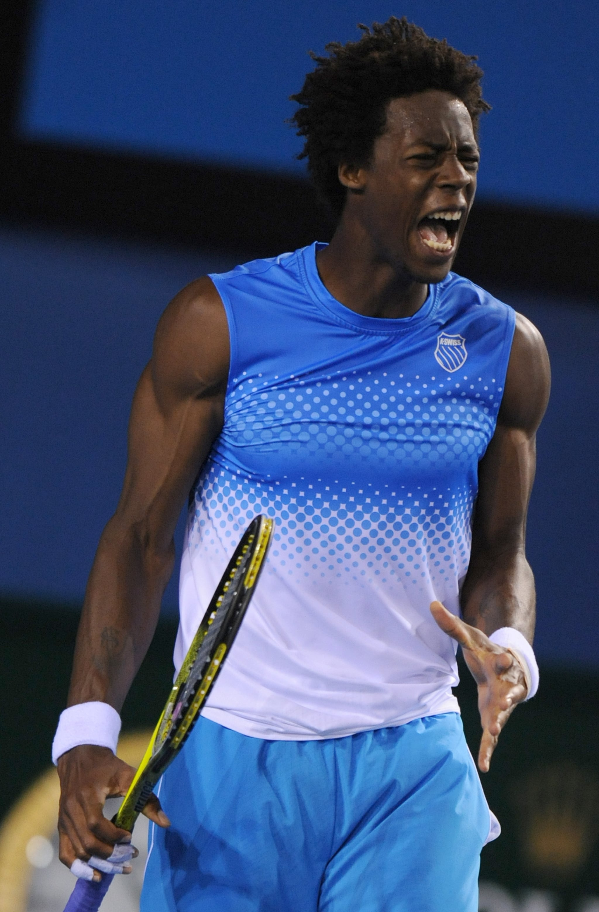 Gael Monfils is one of the best dressed male tennis players as seen here in his white and blue shirts and shorts.