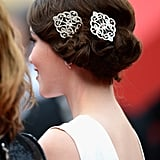 Katie's hair was styled in a vintage coiffure, which she accented with ornate hair clips.