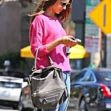 Alessandra Ambrosio carried a cute gray purse.