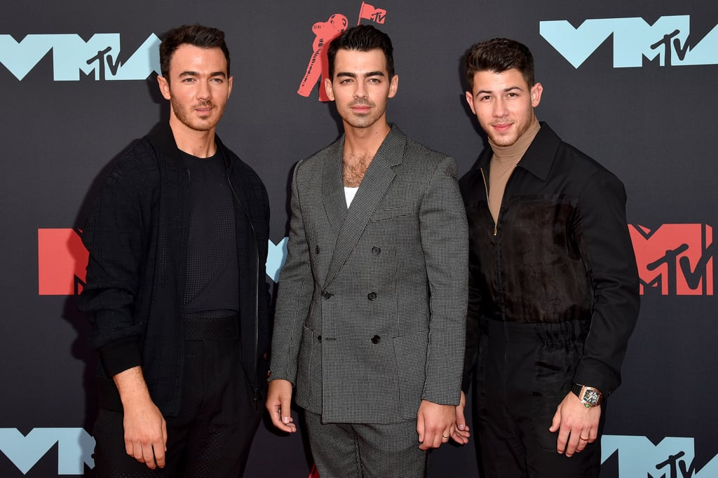"It's been a hot minute since the Jonas Brothers attended the MTV VMAs together, but they made their big return to the show on Monday. Kevin, Joe, and Nick looked dashing in color-coordinated suits as they attended the ceremony in their home state of New Jersey with their wives Danielle Jonas and Sophie Turner. Sadly, Priyanka Chopra was not in attendance. To mark their special night, the Jonas Brothers hit up The Stone Pony for an energetic performance of ""Sucker"" and ""Only Human.""  In addition to taking the stage, the Jonas Brothers won their first ever award for best pop for ""Sucker."" The last time the Jonas Brothers attended the ceremony was all the way back in 2008 when they gave a show-stopping performance of ""Lovebug."" Even though a lot has changed since then, they're still making us swoon a decade later.       Related:                                                                                                           The Jonas Brothers' Crazy Evolution Will Make You Feel Like a Teenager Again"