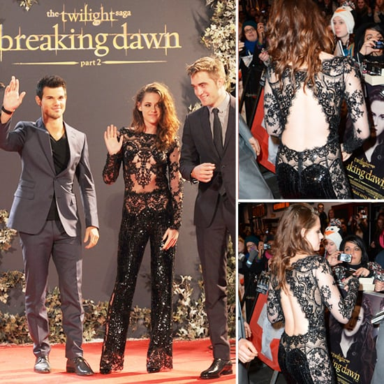 Wow — Kristen Stewart certainly isn't acting shy anymore in the spotlight. She was pictured two evenings ago in a sheer, nude Zuhair Murad gown  for the Los Angeles premiere of The Twilight Saga: Breaking Dawn Part 2, and tonight in London, she is photographed alongside her on and off-screen love Robert Pattinson and Taylor Lautner in another traffic-stopping number created by the same designer. This evening however, she is dressed in a black, shimmery lace-paneled, romper that has a large cut-out from behind. See her formal jumpsuit from all angles and let me know what you think of her look.