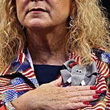 A woman wore an elephant pin on her patriotic garb.