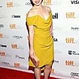 Emilia Clarke wore a yellow dress to hit the red carpet for the Dom Hemingway premiere.