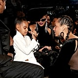 She also couldn't resist showing off her $2,675 heart-shaped Valentino clutch to Alicia Keys at the 2018 Grammys.