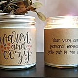 The best part about this Warm and Cozy Candle ($13) is that each jar can contain a personalized message.