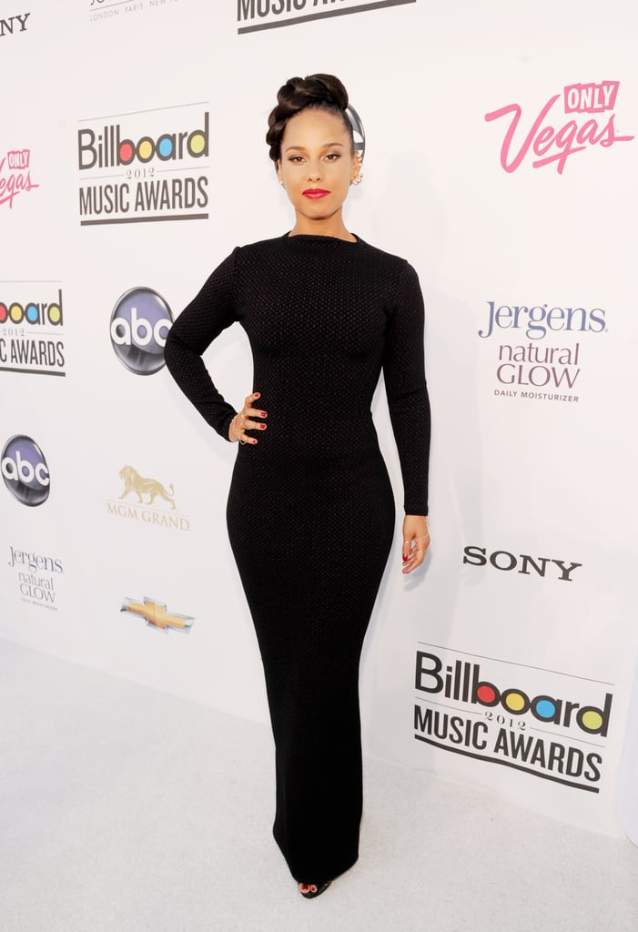 Alicia Keys wore a slinky, albeit totally covered-up, black dress that proved a svelte choice.