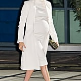Meghan Markle Fall Outfit Idea: A White Turtleneck Dress and Matching Coat