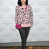 Leigh Lezark topped her gray jeans with pink accents for the Topshop Unique show.