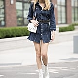 Cinch in your waist with a belted denim dress and match your boots with a chain-link purse.