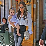 Victoria Beckham carried Harper Beckham out of Pastis.