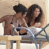 Naomi Campbell relaxed with a friend on a lounge chair in Ibiza.