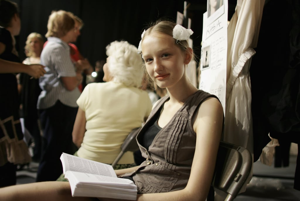 A smiling model looked up from her book during London Fashion Week in 2006.