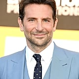 His eyes bounced off of his blue suit at the premiere of A Star Is Born in September 2018.