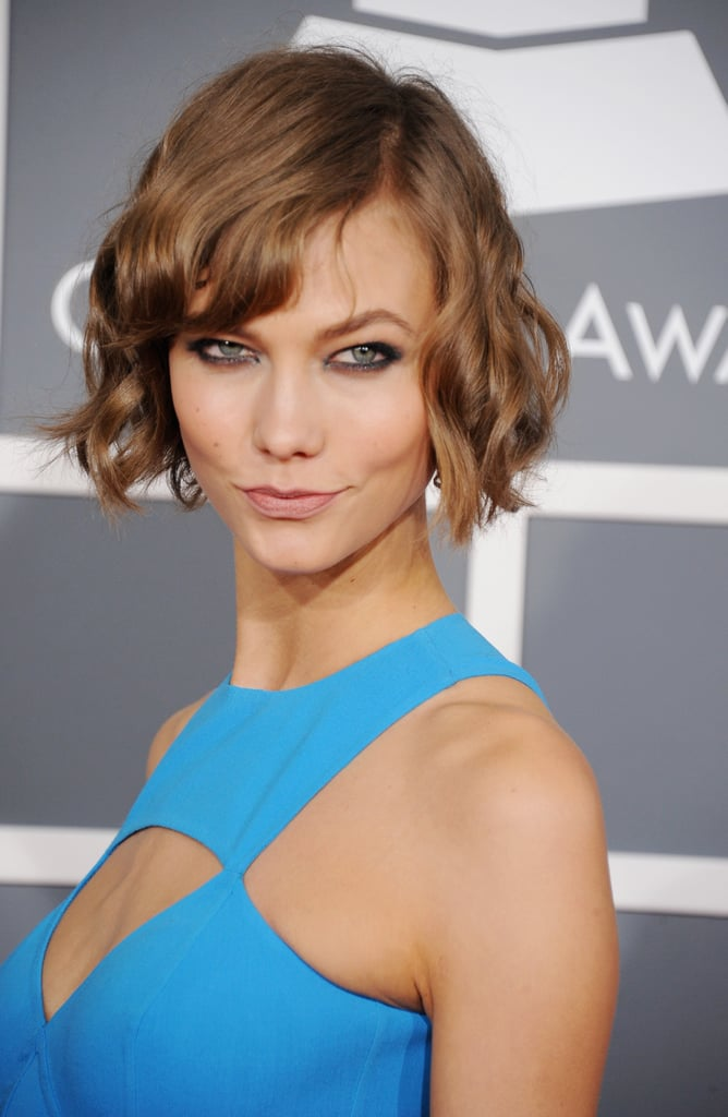 Karlie Kloss wore her short hair curled.