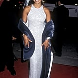 Then: J Lo has always been big on the sparkle, but at the premiere of Selena, she covered up with a furry shawl.