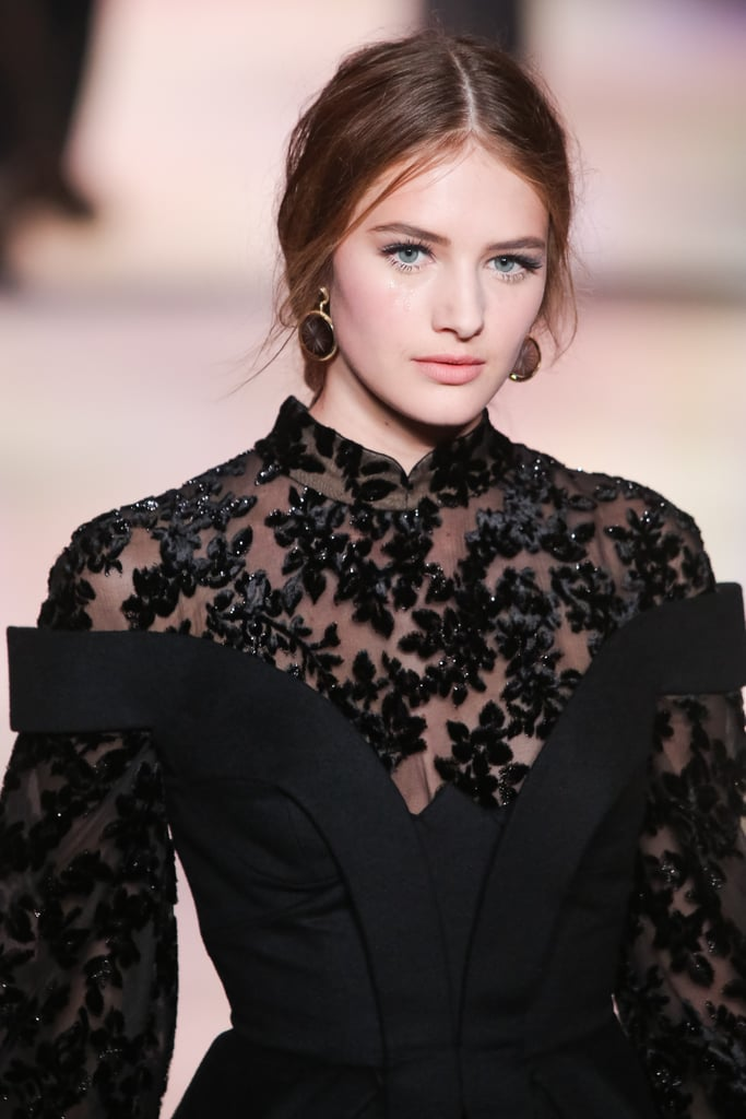 Though somber at first glance, we loved seeing the off-the-shoulder cut layered over lace up close on the Ulyana Sergeenko Haute Couture Fall 2013 runway.