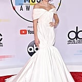 Dua walked the AMAs red carpet in a delicate, off-the-shoulder Giambattista Valli gown.