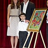 Kate Middleton and Prince William posed proudly with a young artist during their visit to the Rainbow Center in Singapore. The stop was part of their Diamond Jubilee tour in September 2012.