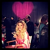 Jessica Hart posed for a photo in front of a pink heart backstage at the Victoria's Secret Fashion Show. Source: Instagram user 1jessicahart