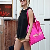 Julianne Hough's legs were on display in a pair of short gold shorts while shopping in St. Barts.
