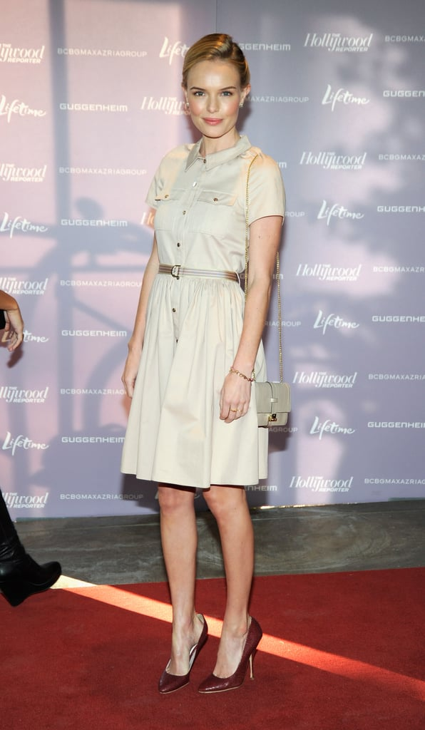 "For this red-carpet look, Kate Bosworth donned maroon pointy pumps, a Mulberry safari-inspired cargo dress, and a Mulberry ""Harriet"" shoulder bag."
