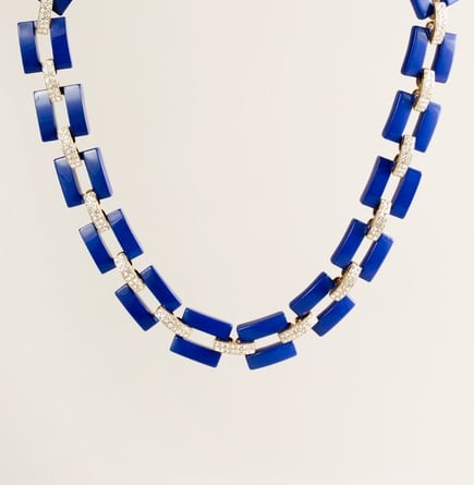 The gorgeous blue hue will pop on anything from a vintage tee to an elegant evening look.   J.Crew Resin and Rhinestone Link Necklace ($85)