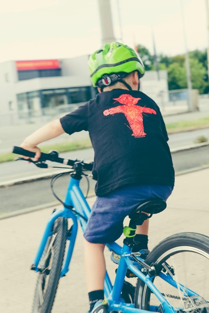 Teach a child how to ride a bike.