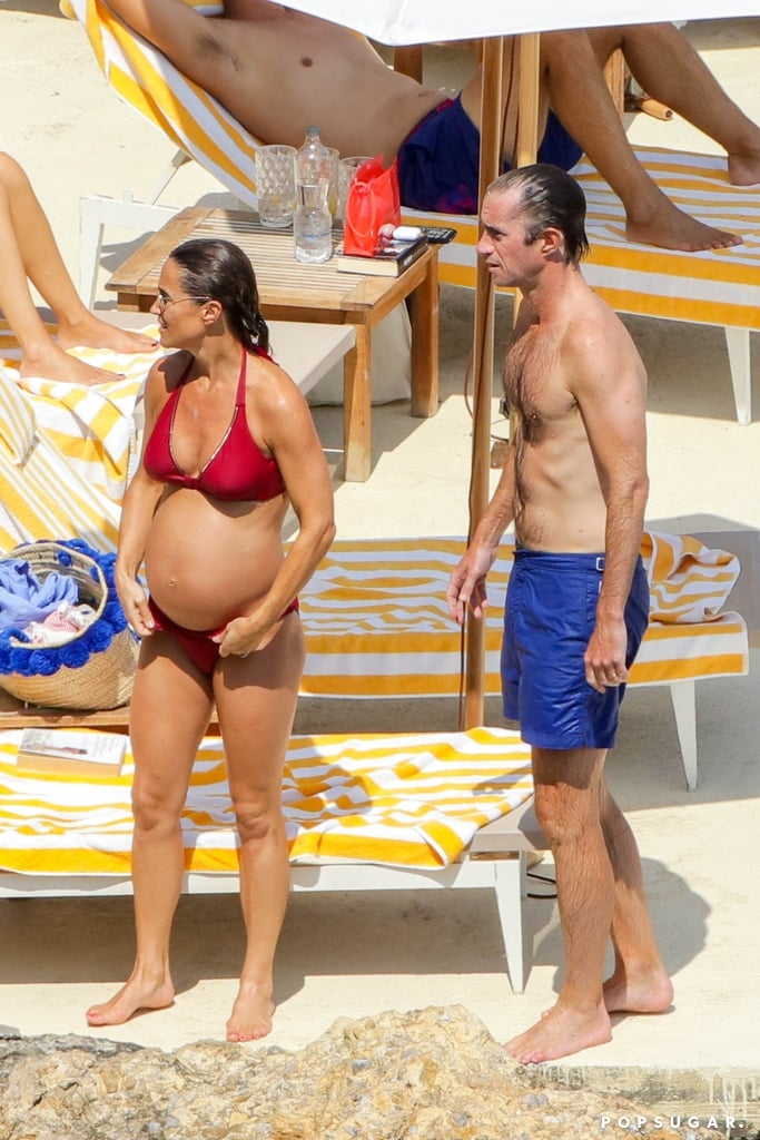 Pippa's growing belly was on display as she hit the beach.