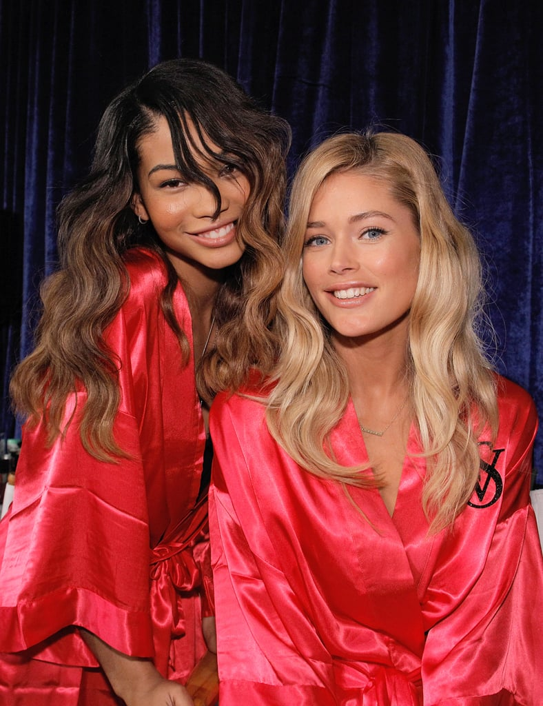 Chanel Iman and Doutzen Kroes wore matching pink robes backstage in 2011.