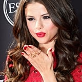 Selena Gomez was the lady in red at the ESPY Awards. She wore ruby lips and nails to match her dress. Hers was our favorite beauty look from the ESPYs red carpet.