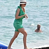 Princess Beatrice in a green romper.