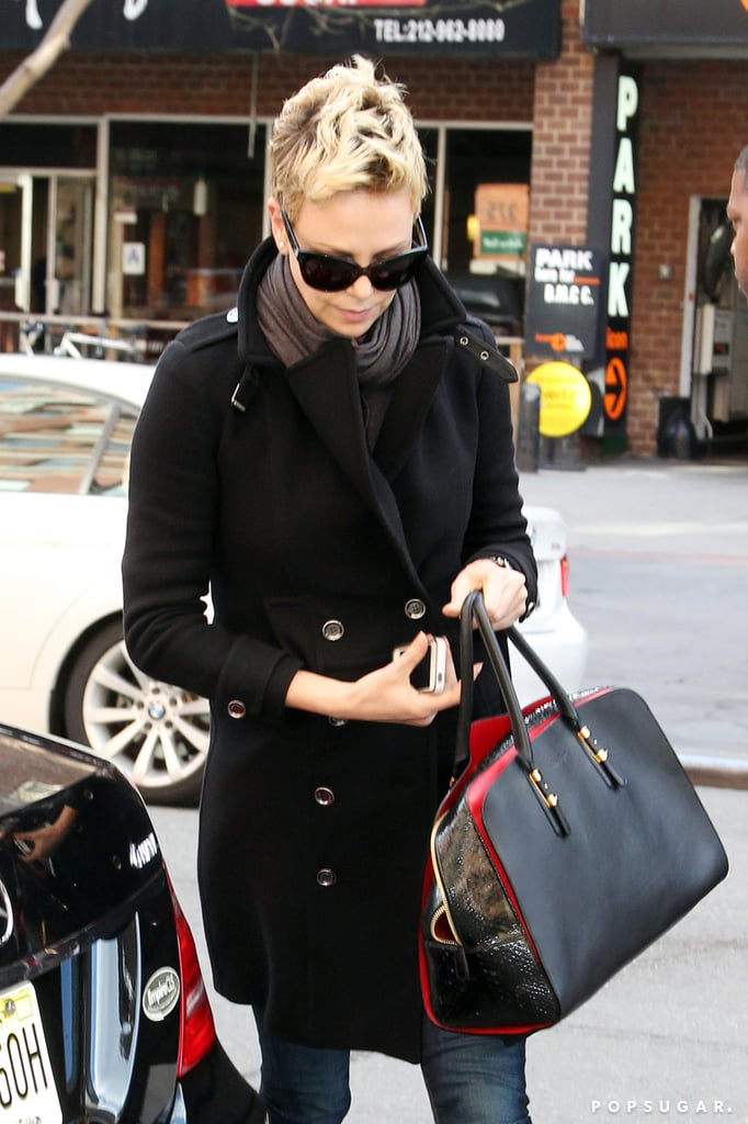 Charlize Theron carried a purse and her iPhone in NYC.